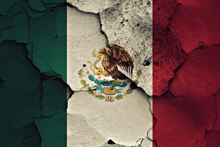 earthquake crack: flag of Mexico painted on cracked wall