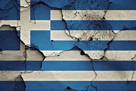 crisis: flag of Greece painted on cracked wall