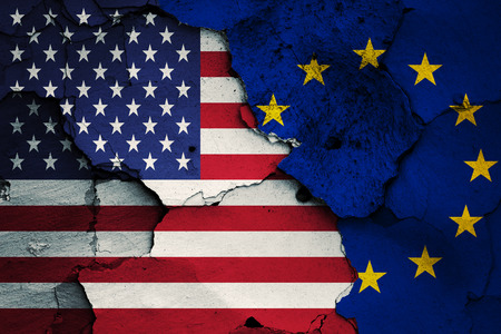 disintegrating: flag of USA and EU painted on cracked wall