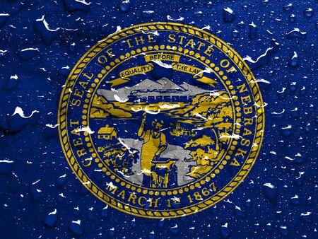 flag of Nebraska with rain drops