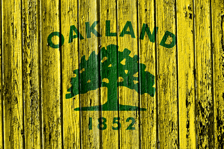 flag of Oakland painted on wooden frame