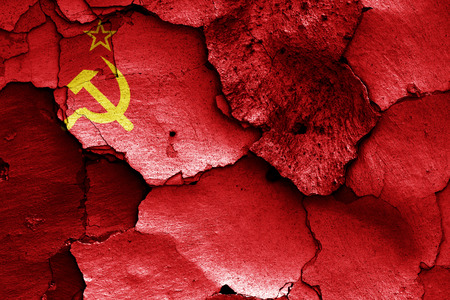 cracked wall: flag of Soviet Union painted on cracked wall