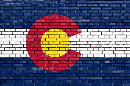 colorado flag: flag of Colorado painted on brick wall