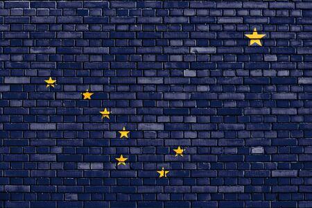 flag of Alaska painted on brick wall