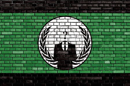 anonymous: flag of Anonymous painted on brick wall