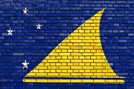 flag of Tokelau painted on brick wall