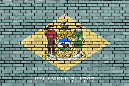 flag of Delaware painted on brick wall