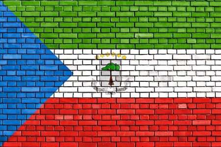 equatorial: flag of Equatorial Guinea painted on brick wall Stock Photo