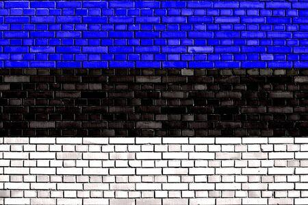 flag of Estonia painted on brick wall