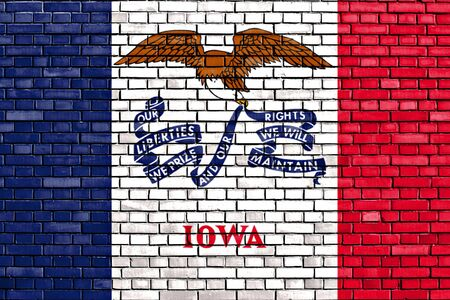 flag of Iowa painted on brick wall