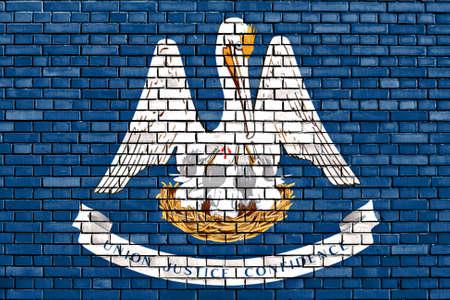 louisiana flag: flag of Louisiana painted on brick wall