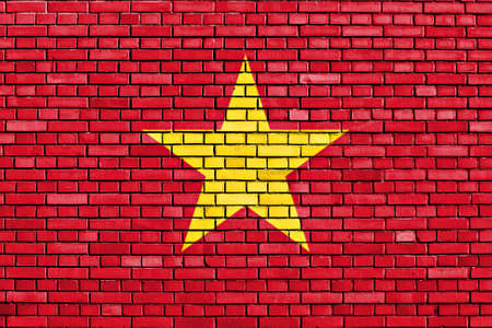 flag of Vietnam painted on brick wall photo