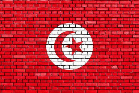 flag of Tunisia painted on brick wall photo