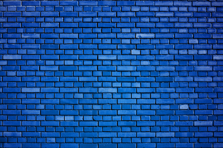 exterior wall: dazzling blue brick wall background Stock Photo