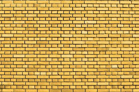 黄色のレンガの壁の背景