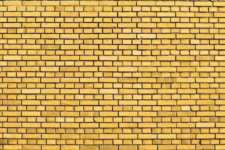 yellow brick wall background Banque d'images