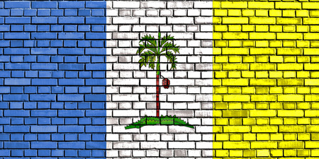 solid blue background: flag of Penang painted on brick wall Stock Photo