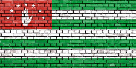 sukhumi: flag of Abkhazia painted on brick wall