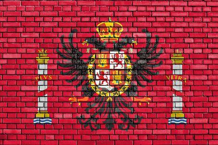 flag of Toledo painted on brick wall