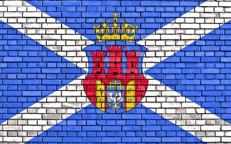 flag of Krakow painted on brick wall