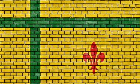 flag of Fransaskois painted on brick wall Stock Photo