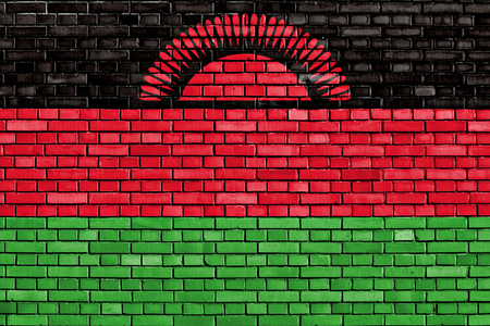 malawian flag: flag of Malawi painted on brick wall