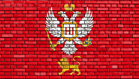 principality: flag of Principality of Montenegro painted on brick wall Stock Photo