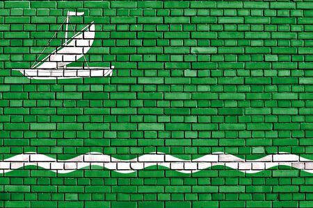 flag of Vilanova de la Barca painted on brick wall Stock Photo