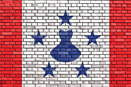 collectivity: flag of Austral Islands painted on brick wall