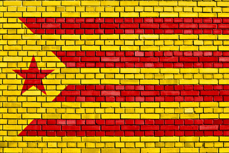 separatist: flag of Catalan separatist movement painted on brick wall Stock Photo