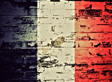 old flag: flag of France painted on brick wall