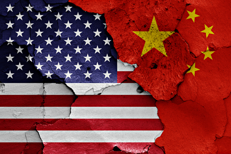 flags of USA and China painted on cracked wall Archivio Fotografico