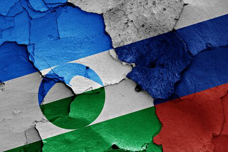 flags of Kabardino-Balkaria and Russia painted on cracked wall Stock Photo