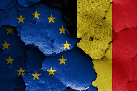 european union flag: flags of EU and Belgium painted on cracked wall Stock Photo