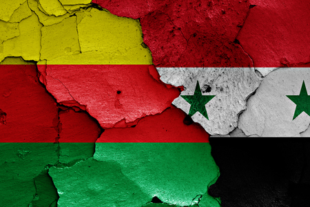 syrian civil war: flags of Syrian Kurdistan and Syria painted on cracked wall