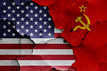 soviet flag: flags of USA and Soviet Union painted on cracked wall