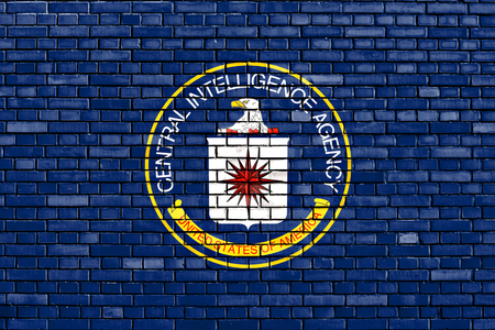 flag of CIA painted on brick wall