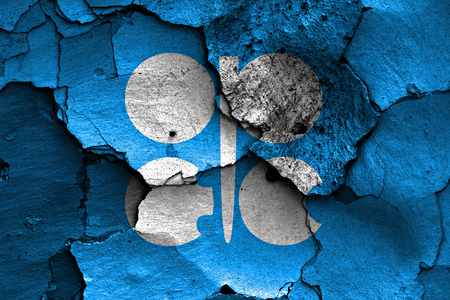 opec: flag of OPEC painted on cracked wall