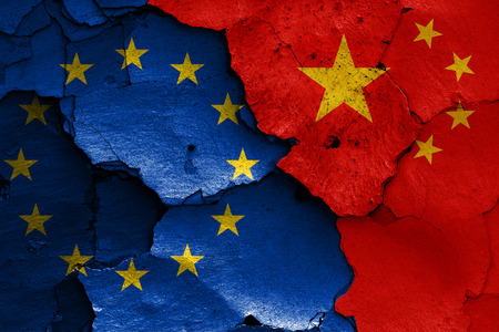 flags of EU and China painted on cracked wall Stock Photo