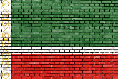 flag of Chechnya painted on brick wall