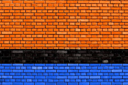 flag of the Chagossians painted on brick wall