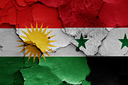 terrorism crisis: flags of Iraqi Kurdistan and Syria painted on cracked wall