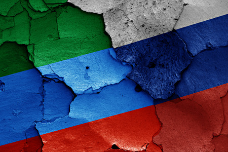 dagestan: flags of Dagestan and Russia painted on cracked wall