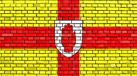 flag of Ulster painted on brick wall