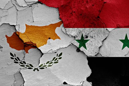 unwelcome: flags of Cyprus and Syria painted on cracked wall