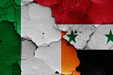 unwelcome: flags of Ireland and Syria painted on cracked wall