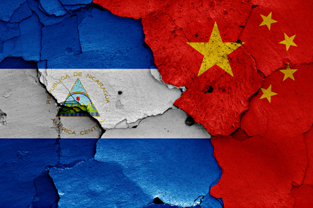 china flag: flags of Nicaragua and China painted on cracked wall