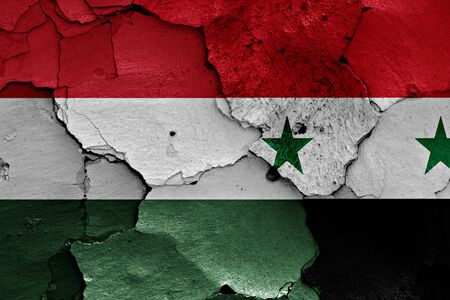 unwelcome: flags of Hungary and Syria painted on cracked wall