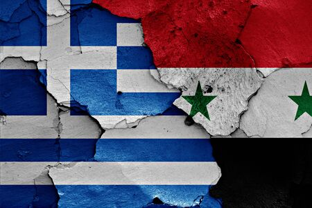 flags of Greece and Syria painted on cracked wall Stock Photo