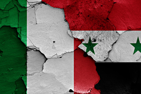 unwelcome: flags of Italy and Syria painted on cracked wall